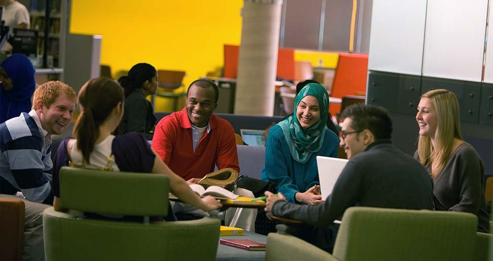 Photo of students sitting in a circle in the library's common area